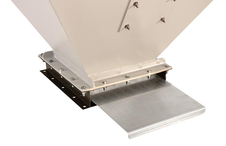 Dry bulk material surge bin with manual slide gate